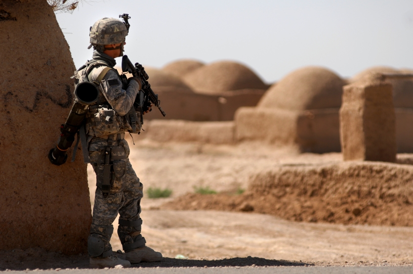 A U.S. Army Private First Class with 782nd Alpha Company pulls perimeter security while other soldiers from his company deliver school supplies and conduct counterinsurgency operations, March 31, 2010, Morgan Kacha village, Southern Afghanistan. School supplies were handed out by ANA soldiers, while troop leaders talked with the village elders. (U.S. Air Force photo by Senior Airman Kenny Holston)